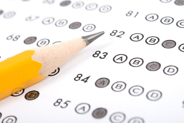 multiple choice testing sheet with pencil