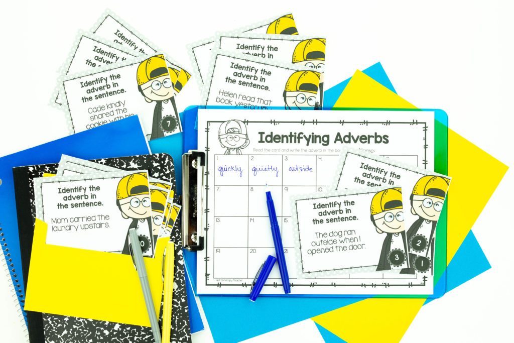 Identifying adverbs grammar activity with task cards and answer sheets on a clipboard