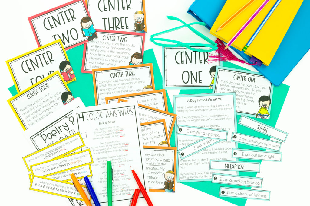 Student center supplies for language arts, including pens, and notebooks