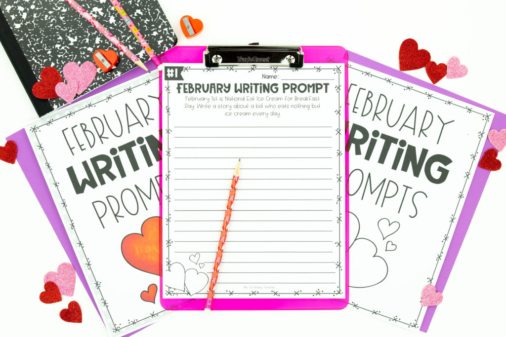 February Writing Prompt on clipboard with cover sheets and composition notebook in background
