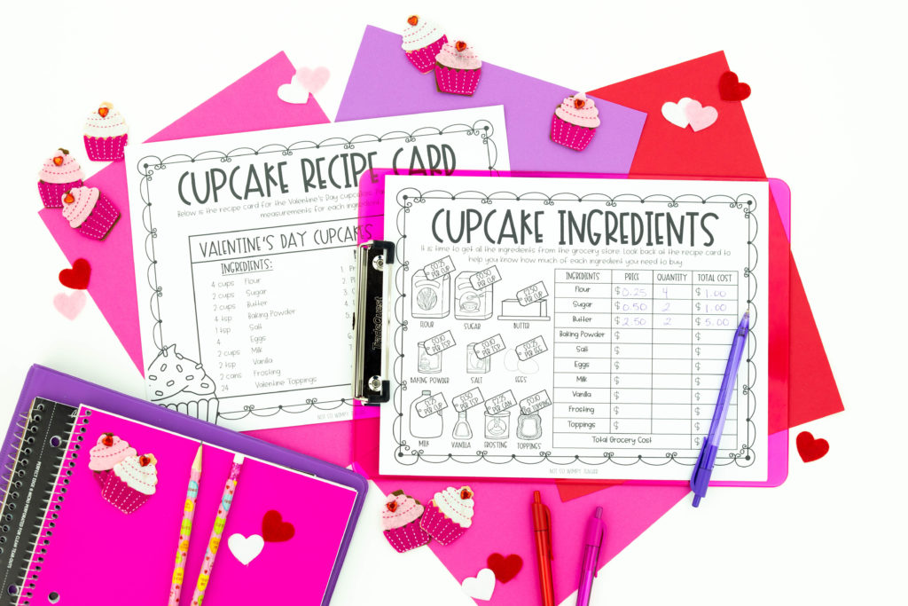 Valentine project used learning pages on clipboards surrounded by pink and purple papers, notebooks and cupcakes