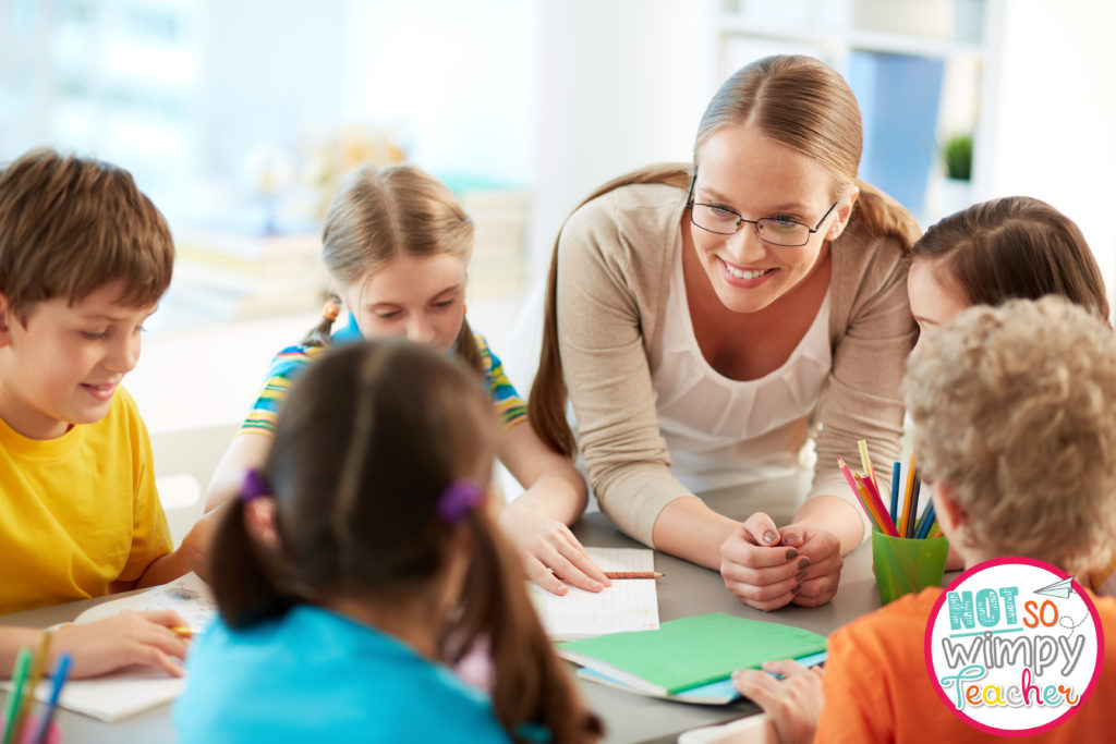Teacher with glasses leaning in and talking to strengthen her connection with students
