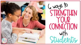 Teacher kneeling on floor talking with student to strengthen connections