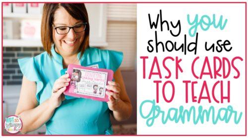 Teacher in teal top holding a task card to teach grammar