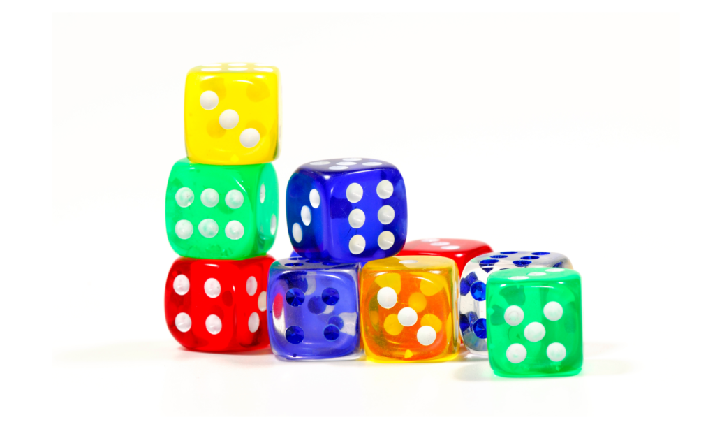 Colorful dice stacked up for the game roll the dice - another way to make review more fun