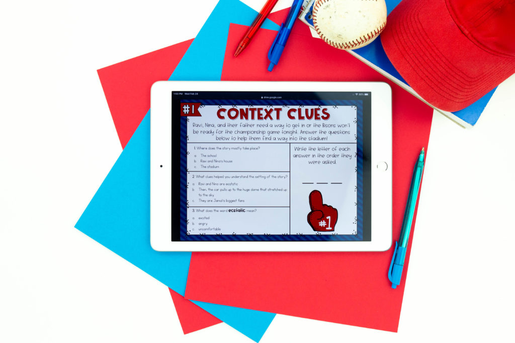 Context clue activity on white iPad with baseball, cap and pens