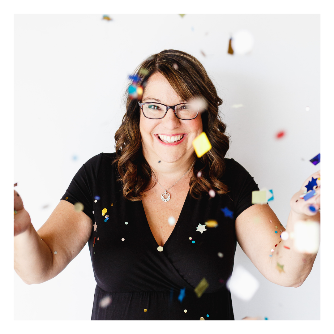 woman with brown hair smiling and throwing confetti